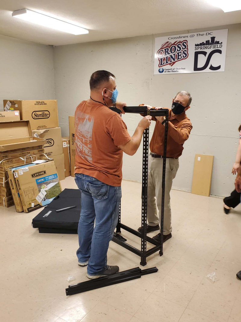 Kenny and Charles assembling storage racks